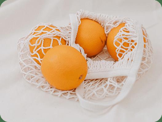 katoenen groente en fruit zakje met sinaasappels